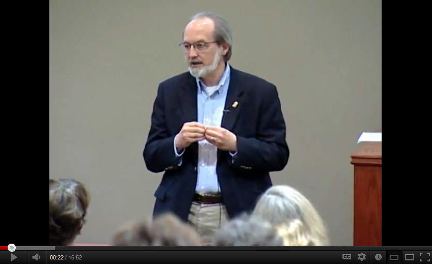 Image of Gregg Vanderheiden giving a presentation on GPII at a conference on aging.
